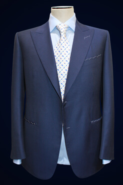 men's custom suit jacket on a stand